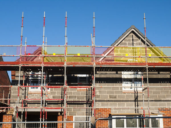 Requiring building warranty insurance